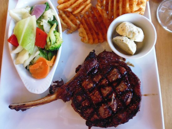 Rustlers Steakhouse and Grill: Rib Eye steak with cross-cut chips, vegetables, and blue cheese butter