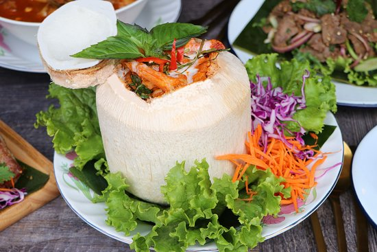 "Y1.""HOR MHOK TALAY MAPRAW ONN"" Sea food custard in coconut shell ห่อหมกทะเลมะพร้าวอ่อน   Shrimp, squid, fish, with coconut milk, red n green curry paste, basil leave, kaffir lime leave, steamed in whole coconut shell"