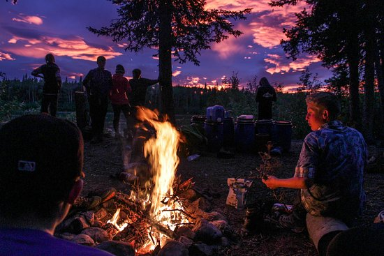 Stories are told and poems are read at the campfire.