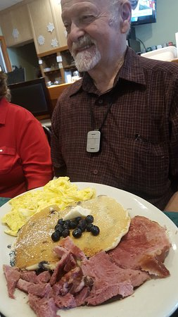 A meal fit for a king. Ham, blueberry pancakes and eggs