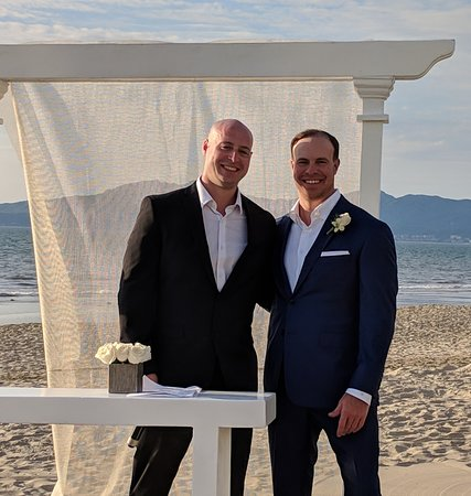 Beach wedding set up, groom and his brother our officiant