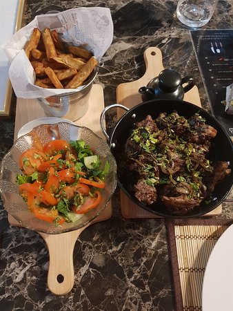 Grilled lamb with sweet potato chips & salad