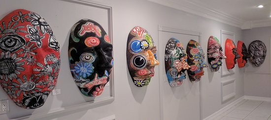"Michael Lucero and the Kosmask, which is a large, lightweight and decorative wall mask. 12 Master artists were invited to design them. Each mask weighs only 4 lbs, and is 35""h x 22""w x 13""d"