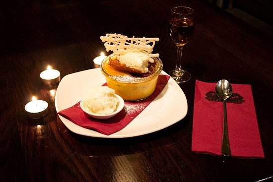 Creme Brulee  Strawberry and white chocolate brulee, brandy snap, chantilly cream and vanilla bean ice cream