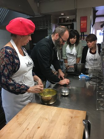 Paris Cooking Class including 3-Course Lunch, Wine & Optional Market Visit: Making the creamy chocolate sauce for dessert with Chef Fred