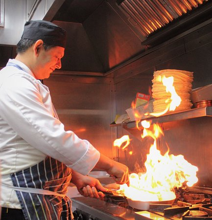 """Chef making the Himalayan special """"Chilli Garlic Chicken"""""""