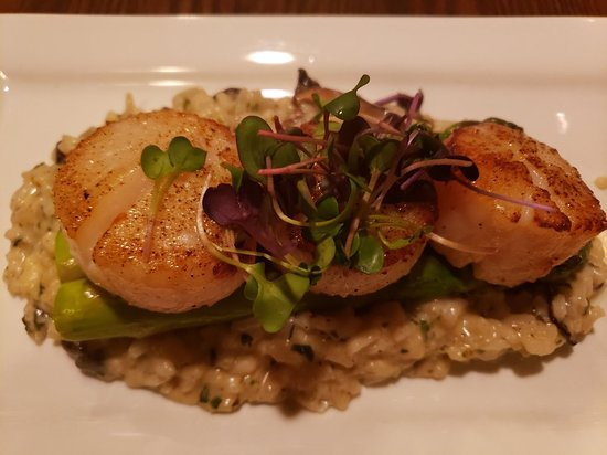 Seared Scallops with asparagus over mushroom risotto.