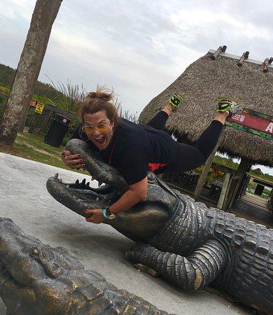 Our Tour Director wrestling a #fakegator at Billie Swamp Safari!
