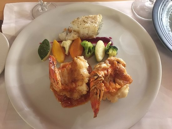 Finest Playa Mujeres: Lobster Tail and a small piece of Chilean Sea Bass at Seaside Restaurant