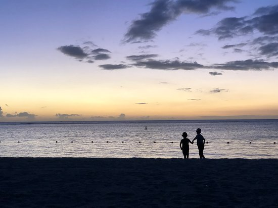 Or sons enjoying the sunset on the beach near our room