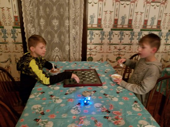 Sardis, MS: Frog's Pearl - grand son's playing checkers
