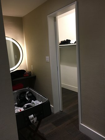 The Tuscany - A St Giles Signature Hotel: Vanity and walk in closet (iron and ironing board included)
