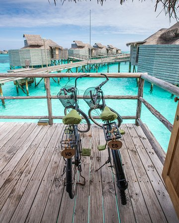 ‪‪Olhuveli Island‬: Last year we visited Six Senses Laamu in the Maldives and I called it our favorite resort in the world. We returned this year and, yes, it's still our favorite. Not only are the overwater villas amazing - they come with bicycles with personalized initial plates. Oh, and you don't wear shoes your entire stay!‬