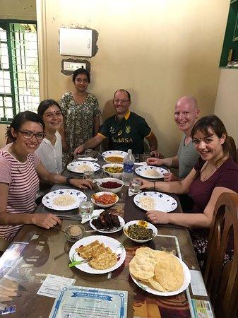 Travelers enjoying home cooked food in Kerala