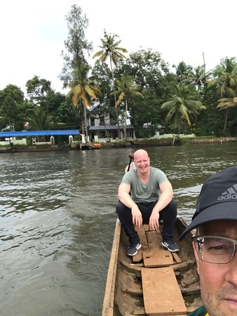 Travelers enjoying the local boat cruise in Alleppey