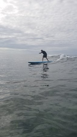 Amy paddled out to get this photo!  Old guy surfing!
