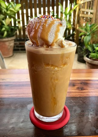 coffee blended with caramel syrup, top with whipped cream and caramel syrup