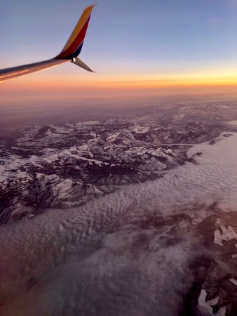 Southwest Airlines: The mountains had some snow and the valleys were filled with clouds.