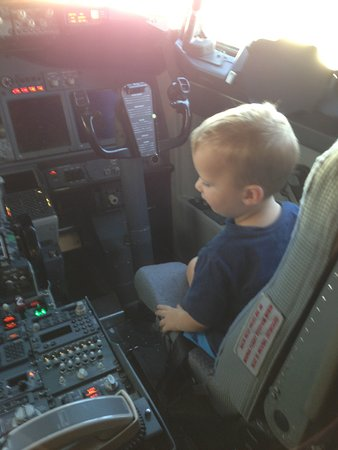 Qantas: One of my grandsons (Jaxx) came on a flight to Perth with me and the pilots let him in the pilots seat (after we landed lol) it certainly made his day (and mine). Just another part of the service.