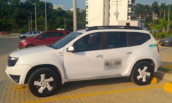 Chauffeur Bogota: Transport in Compact sudan