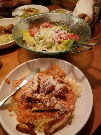 All you can eat salad and angel hair pasta, 3-cheese marinara sauce with crispy, fried chicken strips