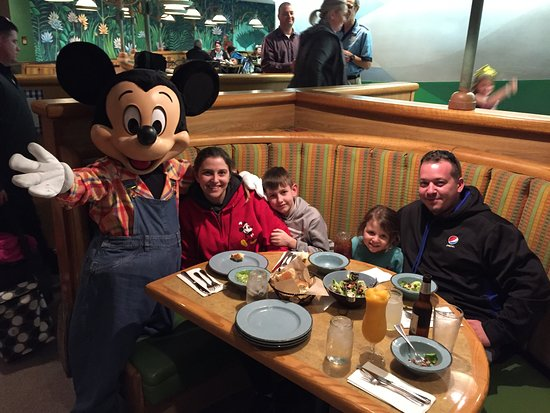 Garden Grill: Mickey was cool enough to sit with us and take a picture without us even having to ask for any sort of family picture. For the other characters we had the kids duck out under the table and take their picture with them.