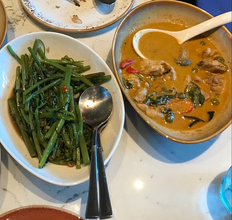 Wok fried morning glory and chicken green curry