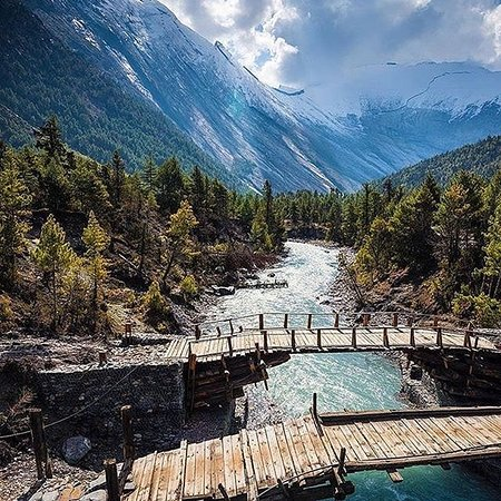 Manang, Nepal: Bridge built of wooden, which holds overloads firmly.