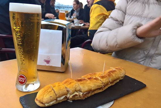 Walk & Bites: A 'fino' of Super Bock (the local beer) with traditional pork and cheese sandwich