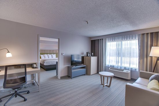 Country Inn & Suites by Radisson Wichita East: 1 bedroom suite living area. (door separating rooms)