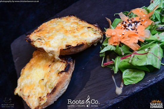 Roots & Co Roots Rarebit |  Mature cheddar, leeks, local ale on toasted rustic bread 20 Post Office Road 01202 558399