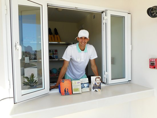 The Club House.  Jorge,one of the activity leaders is showing the start of the Iberostar lending library.
