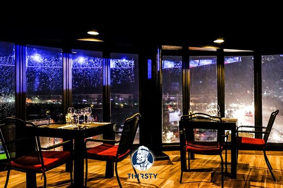 Thirsty Barons: Our steak house, a beautiful view even on a rainy evening!