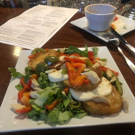 Fried green tomatoes mozzarella top with a small amount crab meat they added peppers to salad i would get without next time but pretty good salad