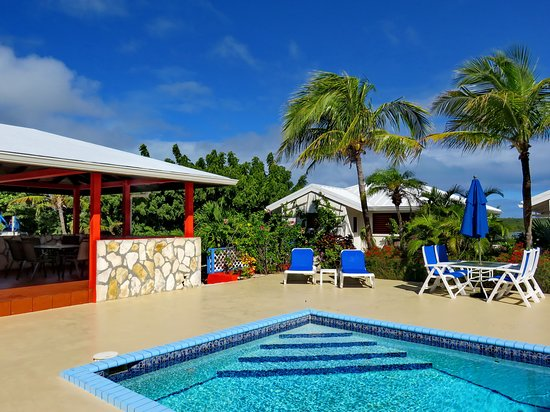 Poolside at the villas with tikihut for barbecues.