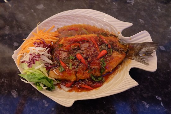 Whole sea bass deep fried topped with spicy sauce