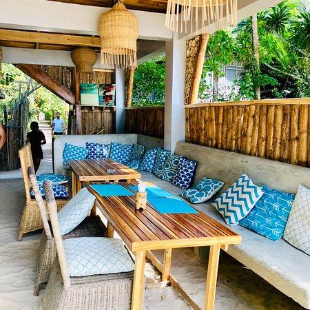 Shows a set of tables and cushions at Bella Vita restaurants