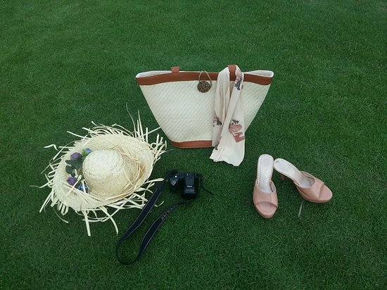 the tropical real straw bag , it is unique , special in market   it is made by hand . material : real straw - coconut button - hemp string and lace decoration  size bag : W 42 cm - H 35 cm .  price : 25$/ unit ( bag - hat ) buying 5 free 01   door to door delivery from 1 - 3 day