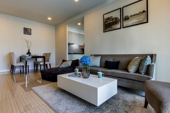 One Bedrooms Have A Separated Living Room With Dining Table Large Led Tv Private Balcony And Sofa Picture Of Metropole Residence Bangkok Tripadvisor