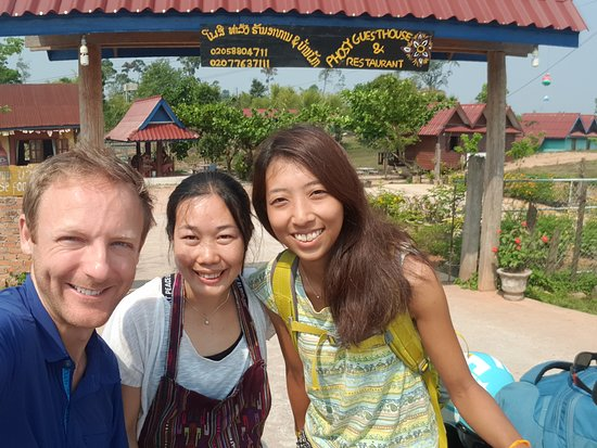 Khammouane, Laos: front gate, with my friend and one of the family members owning the place