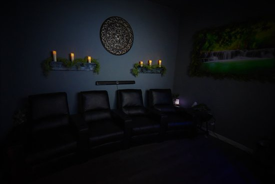 A Beautiful Tranquility room to relax in before and after your service. We also offer foot and leg massages in here!