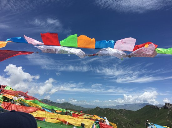 Tibet World Travel: Beautiful skies and prayer flags everywhere