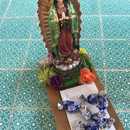 The Virgin of Guadalupe brings you some caramelos with the check