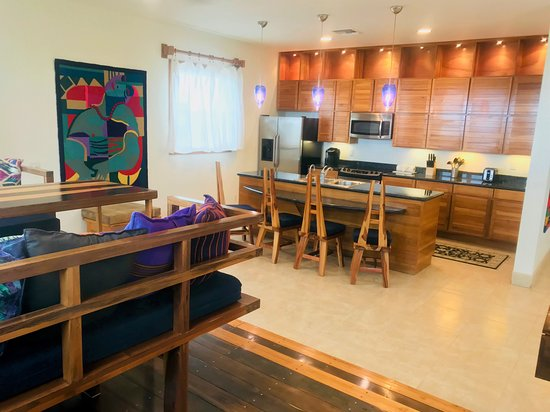 The dining room and kitchen of our spacious 1 BR Beachfront Suite.