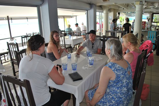 Holetown, Barbados: Zaccios provide table water while waiting on menus