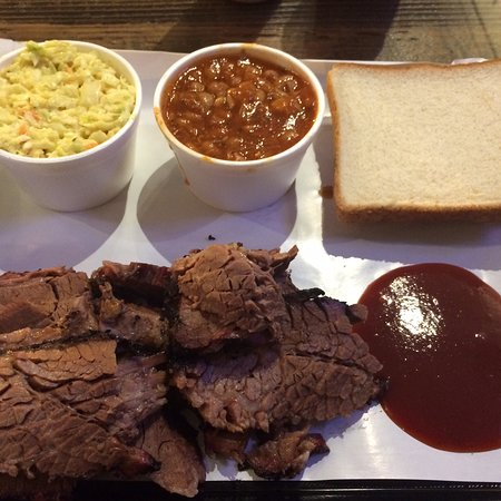 Sliced brisket with cole slaw and beans, delicious.