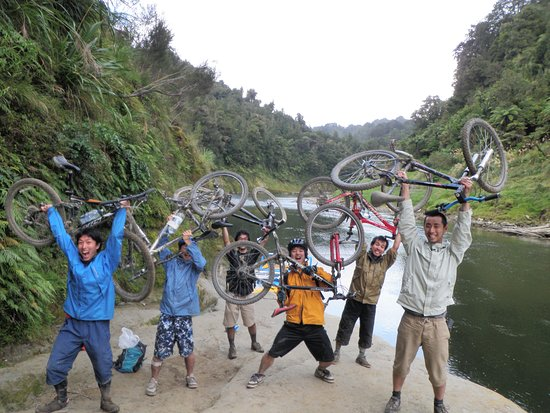 Some very happy riders after completing the Bridge to Nowhere/Mangapurua Track with us.