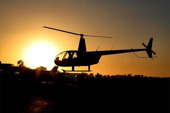 Voo noturno romântico de helicóptero...