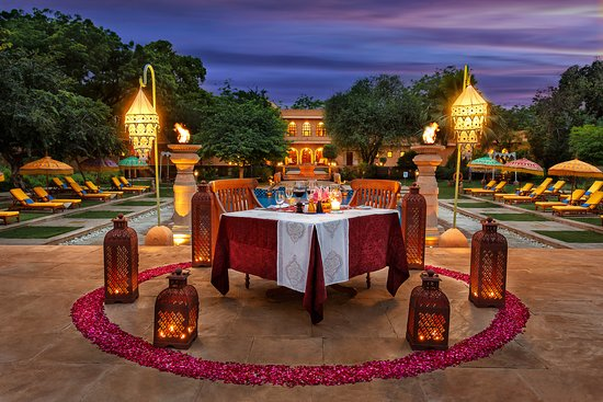 Romantic Dinner Setup by the Pool Side