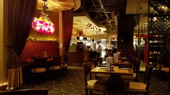 CRAVE American Kitchen & Sushi Bar: A view from our table toward the kitchen